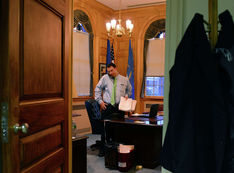 Mayor Ben Blake works in his office at Milford City Hall in Milford, Conn., on Tuesday Dec. 16, 2014. To no one's surprise, he'll be running for the mayor's seat again in November. The Republican Town Committee will pick their slate of candidates Monday Night. Photo: Christian Abraham / Christian Abraham / Connecticut Post