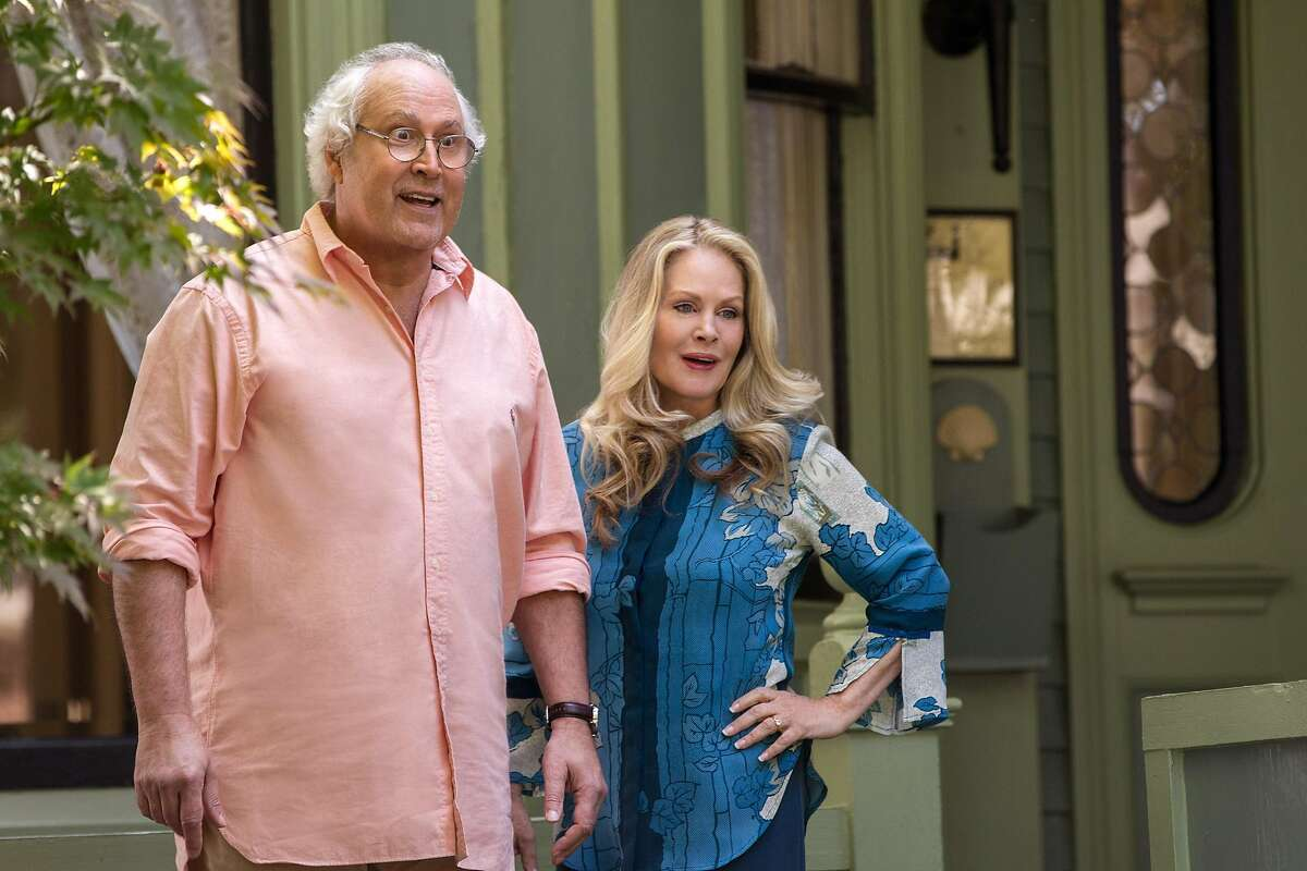 """In this image released by Warner Bros. Entertainment, Chevy Chase, left, and Beverly D'Angelo appear in a scene from """"Vacation."""" (Hopper Stone/Warner Bros. Entertainment via AP)"""