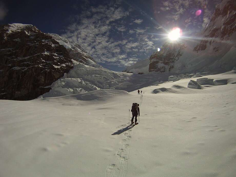 Artist Denali Schmidt climbing Mount Rainier. His work is on exhibit at the White Walls Gallery. Photo: Denali Foundation