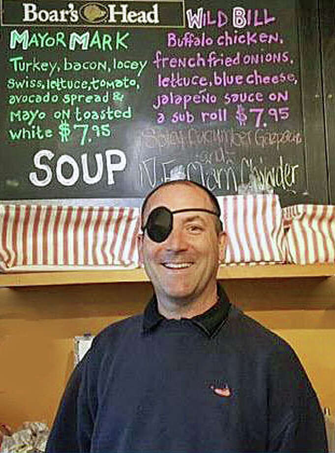 Ted Cutsumpas and the MayorMark sandwich (in green lettering) at the Elm Street Market in Bennington, VT Photo: / Twitter