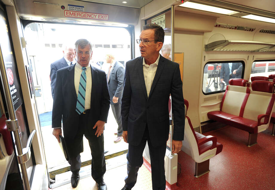 DOT Commissioner James Redeker, left, and Gov. Dannel P. Malloy tour a new Metro North commuter train car following Malloy's announcement on improvements for the New Haven Line at Union Station in New Haven, Conn. on Monday, July 27, 2015. Photo: Brian A. Pounds / Hearst Connecticut Media / Connecticut Post