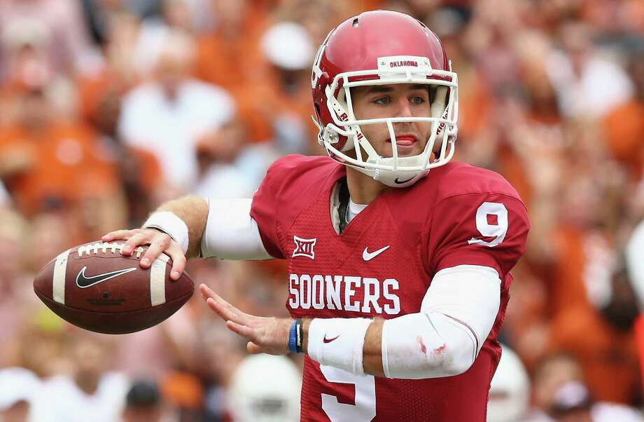 Oklahoma's Trevor Knight, a former Reagan standout, throws against Texas at the Cotton Bowl on Oct. 11, 2014 in Dallas. Photo: Ronald Martinez /Getty Images / 2014 Getty Images