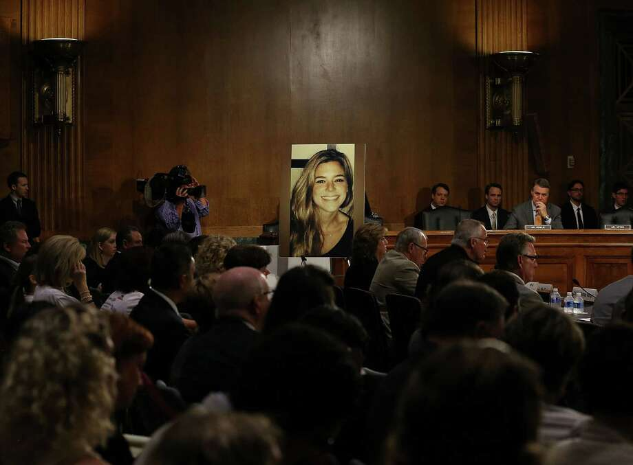"WASHINGTON, DC - JULY 21: A large photo of Kathryn ""Kate"" Steinle who was killed by an illegal immigrant in San Francisco, is shown while her dad Jim Steinle testifies during a Senate Judiciary Committee hearing on Capitol Hill, July 21, 2015 in Washington, DC. The committee heard testimony from family members who have had loved ones killed by illegal immigrants.   (Photo by Mark Wilson/Getty Images) Photo: Mark Wilson, Staff / 2015 Getty Images"