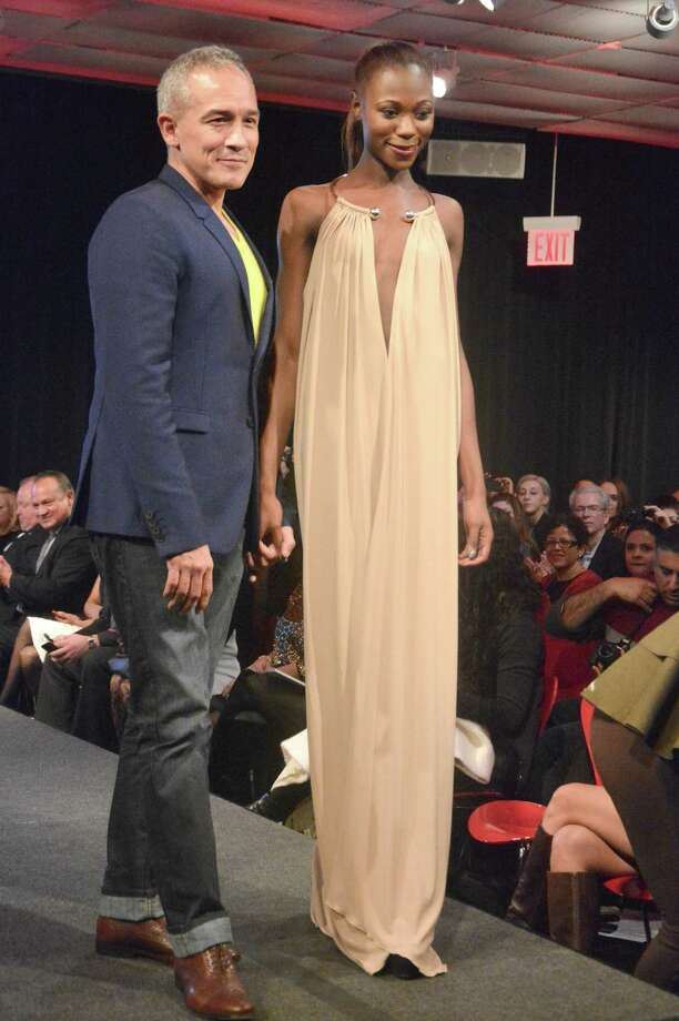 Houston-born designer and New York Fashion Week regular Cesar Galindo, third from left, strikes a pose with models after showing his fall/winter 2015 collection in New York. On July 30, 2015, Galindo will present a free fashion show at San Antonio's St. Anthony Hotel highlighting that collection. Photo: Courtesy John Caballero / San Antonio Express-News
