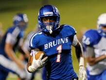 West Brook Bruin Keith Corbin, 1, runs for a nice gain against the Taylor Mustangs at the Carroll Thomas Stadium.