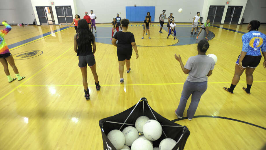 Ozen players work drills with junior high athletes during the Panther's volley ball camp on Monday.  Photo taken Monday, July 27, 2015 Guiseppe Barranco/The Enterprise Photo: Guiseppe Barranco, Photo Editor