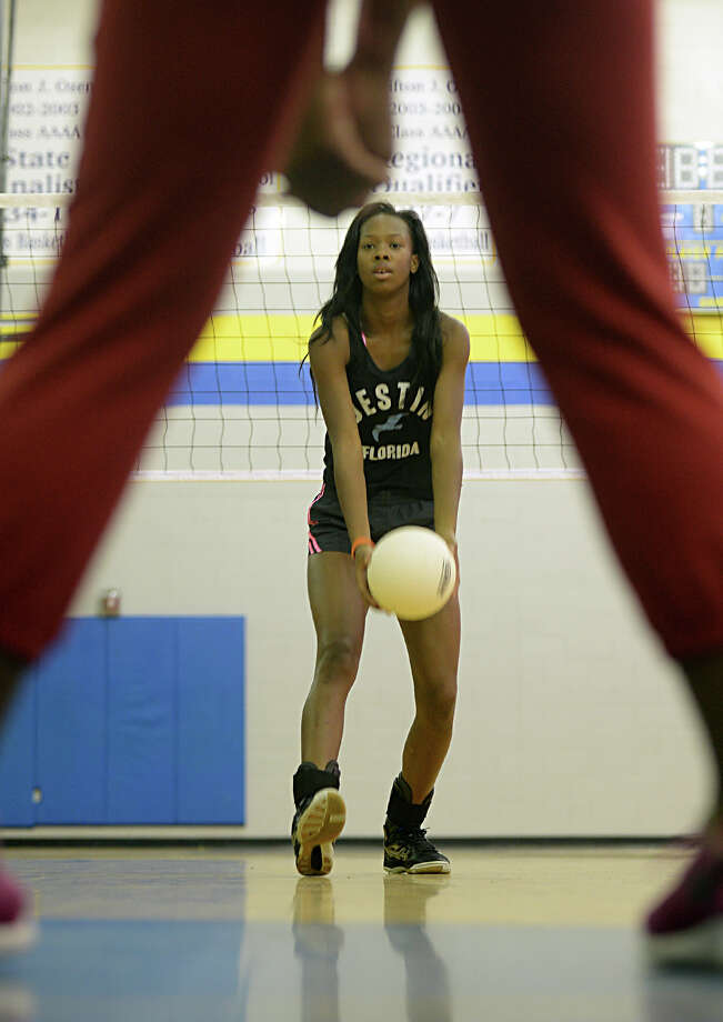 Ozen's Mercedes Perry tosses the ball to a junior high participant of the Panther's volley ball camp on Monday. 