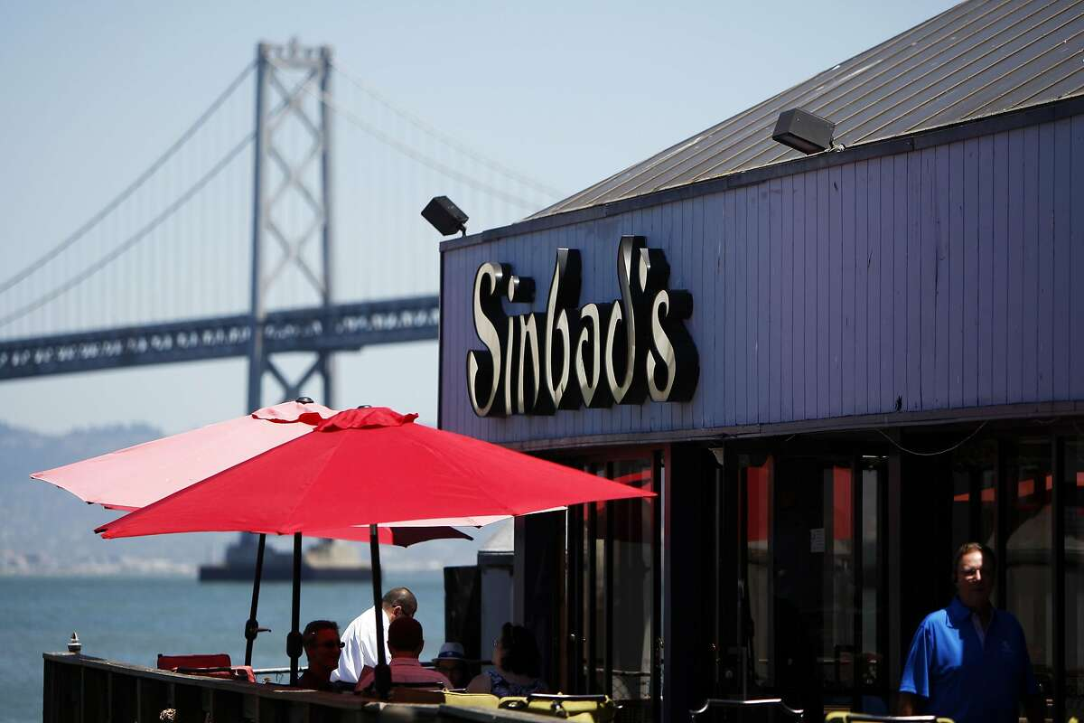 People eat lunch on the patio at Sinbad's in San Francisco on Monday, July 27, 2015.