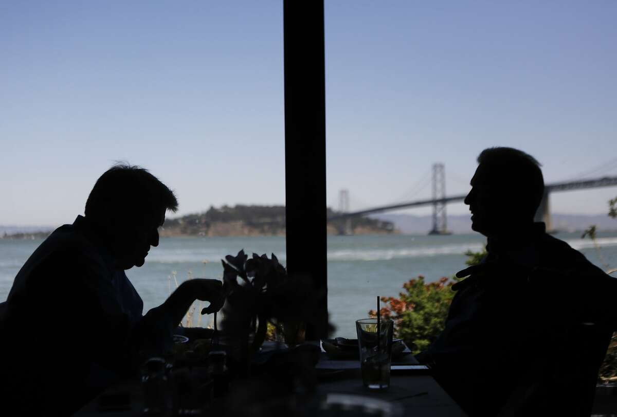 Paul Levins of Australia, left, and Mark Klopp of Danville eat lunch together at Sinbad's in San Francisco on Monday, July 27, 2015.