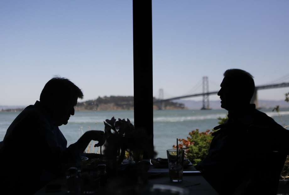 Paul Levins of Australia, left, and Mark Klopp of Danville eat lunch together at Sinbad's in San Francisco on Monday, July 27, 2015. Photo: Dorothy Edwards, The Chronicle