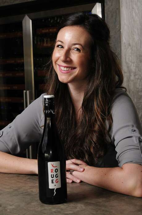 Camerata sommelier Lindsay Thomas with a bottle of Le Sot de L'Ange Rouge Gamay/Grolleau 2014 Friday July 24, 2015.(Dave Rossman photo) Photo: Dave Rossman, Freelance / Freelalnce