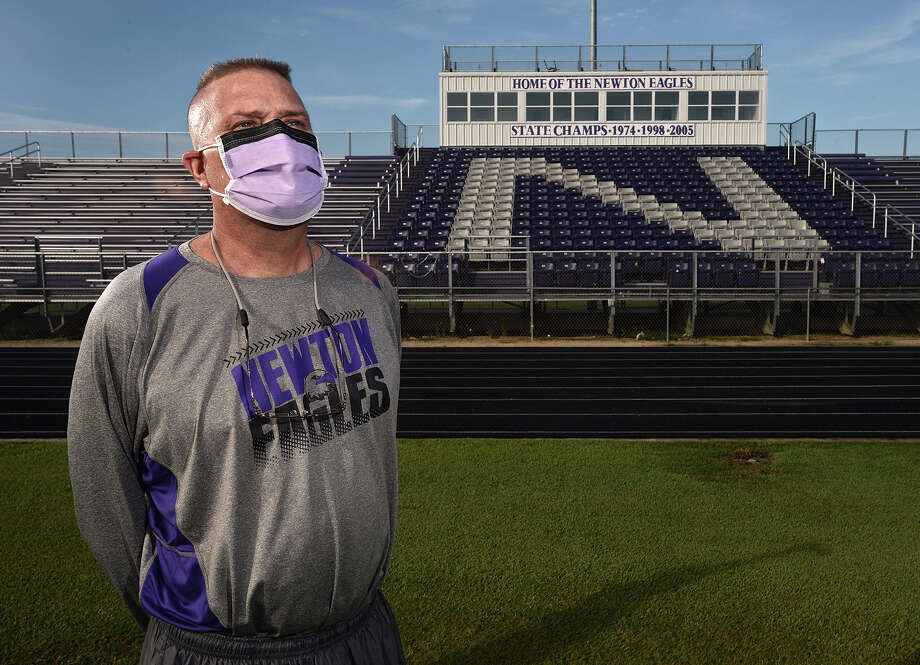 Newton's football coach W.T. Johnston who is suffering from Graft-versus-host disease at the Eagle's stadium on Thursday. Johnston said he is determined to coach the team this season.  Photo taken Thursday, July 23, 2015   Guiseppe Barranco/The Enterprise Photo: Guiseppe Barranco, Photo Editor