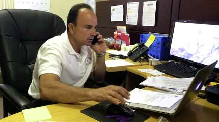 Joe Ganim furiously works the phones at his campaign headquarters on Hudson St. in Bridgeport, Conn. Monday, July 20, 2015.