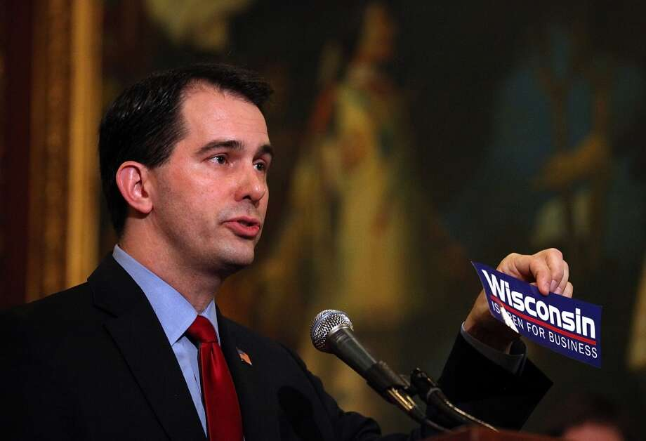 """Minimum wage: Walker is no believer in minimum pay, either in his home state or in raising the $7.25 an hour federal minimum wage. On the night of his announcement, Walker told Sean Hannity on Fox News:""""The left claims they're for American workers, and they've got lame ideas -- things like the minimum wage. We need to talk about how we get people skills and qualifications they need to get jobs that go behind the minimum wage."""" Photo: Justin Sullivan, Getty Images"""