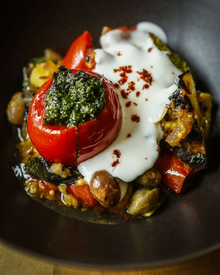 Julya Shin's Shelling Bean and Summer Vegetable Gratin with a stuffed tomato and plain yogurt is seen in her home kitchen on Monday, July 20, 2015 in Oakland, Calif. Photo: Russell Yip, The Chronicle