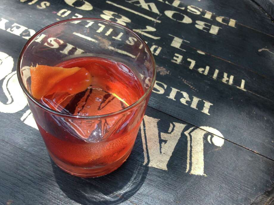 Broadway Junction is a cocktail made with Jameson Black Barrel, bitters and Campari. It was served during 2015 Tales of the Cocktail in New Orleans. Photo: Greg Morago / Greg Morago