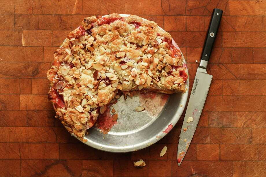 A Peach- Raspberry Almond Streusel Pie satisfies the criteria of ripe summer fruit, flaky bottom crust and crumbly topping.Keep clicking for more pie recipes we strongly recommend.  Photo: Loren Elliott, Staff / ONLINE_YES