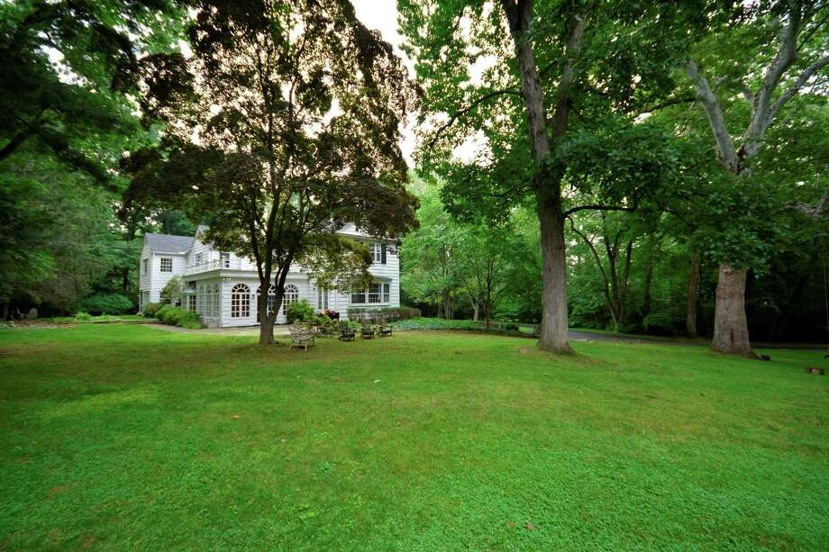 This three-acre park-like estate on St. Nicholas Road in Darien was built in 1938. Photo: Contributed / Contributed Photo / Darien News