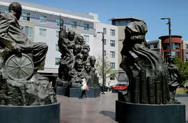 "A new Oakland law — a copy of many cities' similar mandates — requires builders to set aside funding for public artworks, such as the ""Remember Them"" sculptures just off 19th Street in downtown Oakland."