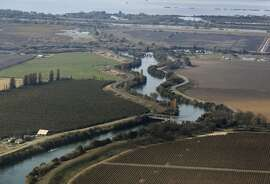 Fertile farmland are protected by levees lining a slough in the Sacramento-San Joaquin River Delta on Wednesday, Nov. 9, 2011. If built, the Peripheral Canal would divert fresh water to the south and could have a significant impact on the future of the delta, its wildlife and local farming.