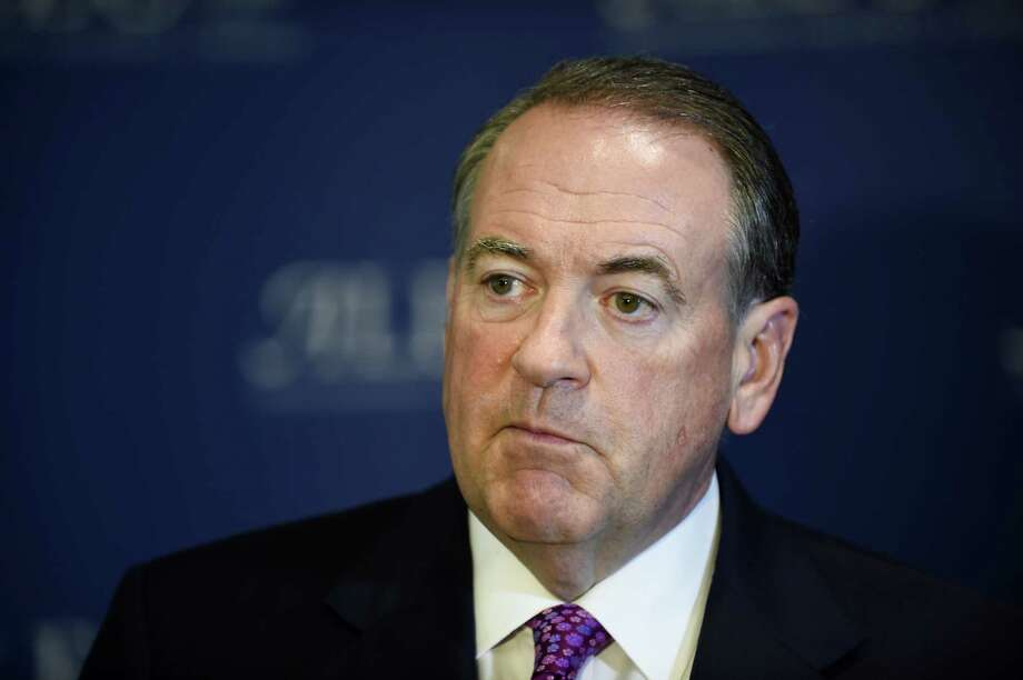 Republican presidential candidate former Arkansas Governor Mike Huckabee speaks at the American Legislative Exchange Council 42nd annual meeting Thursday, July 23, 2015 in San Diego.  (AP Photo/Denis Poroy) Photo: Denis Poroy, FRE / Associated Press / FR59680 AP