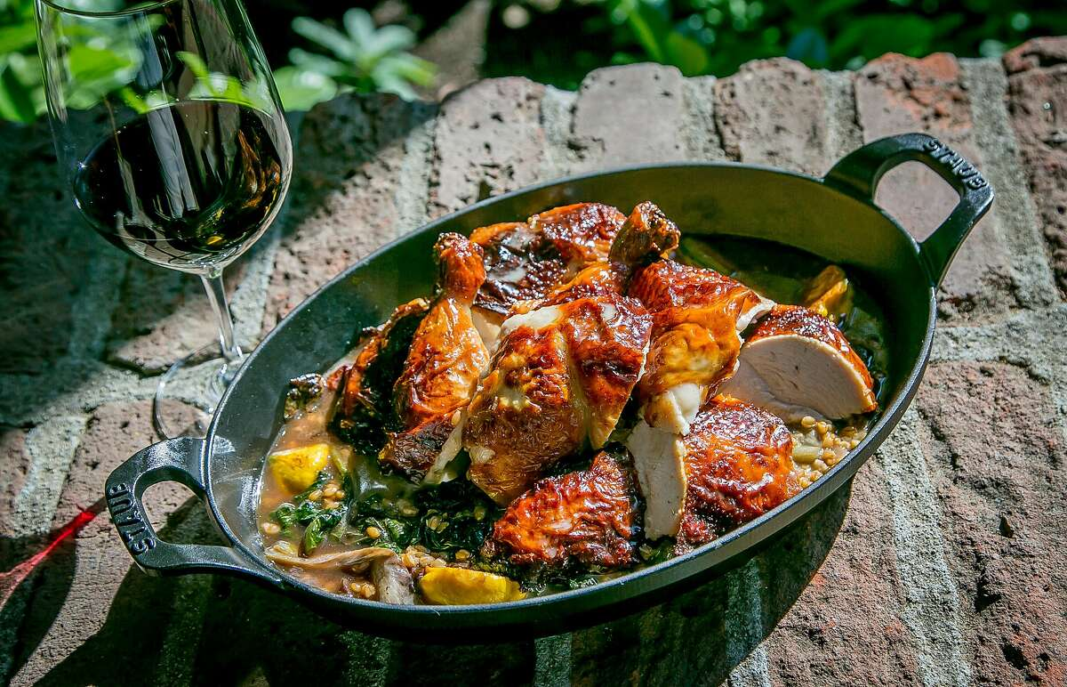 The Roast Chicken with a glass of red wine at Harvest Table in St. Helena, Calif., is seen July 26th, 2015.
