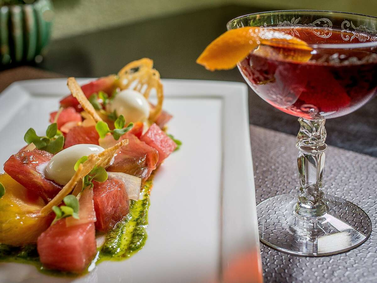 The Tomato and Watermelon salad with a white wine Negroni at Harvest Table in St. Helena, Calif., is seen on July 26th, 2015.