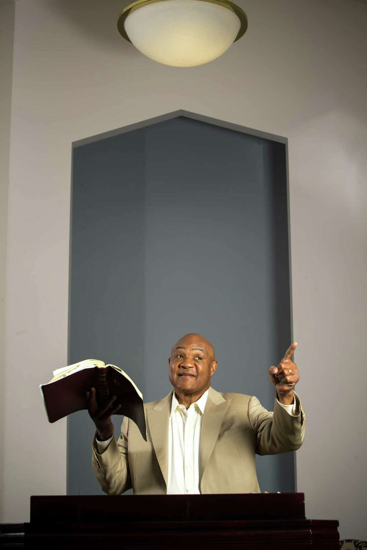 George Foreman, former heavyweight boxing champion, who is now a minister, poses for a portrait in the sanctuary of his church on Thursday, July 23, 2015, in Houston. ( Brett Coomer / Houston Chronicle )