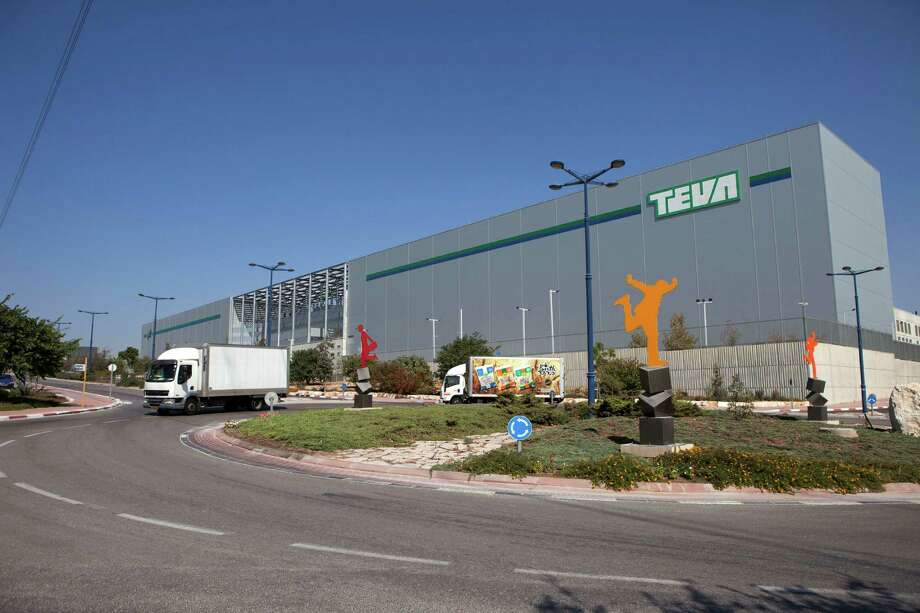 FILE - This Wednesday, Oct. 16, 2013 file photo shows trucks run past Teva Pharmaceutical Logistic Center in the town of Shoam, Israel. Israel's Teva Pharmaceutical Industries Ltd. said Monday it is purchasing Dublin-based Allergan PLC's generic pharmaceuticals business for $40.5 billion, in what Israeli analysts called the largest-ever acquisition by an Israeli company. (AP Photo/Dan Balilty, File) ORG XMIT: DV101 Photo: Dan Balilty / AP