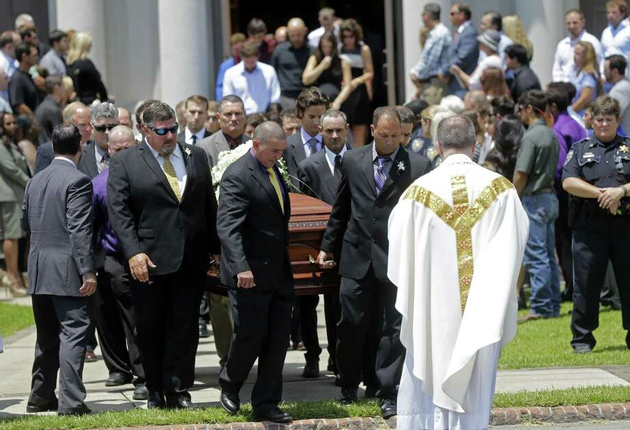 The casket of Mayci Breaux is carried out of the Church of the Assumption, after her funeral in Franklin, La., Monday, July 27, 2015. She was one of two people killed in Thursday's movie theater shooting in Lafayette, La.  (AP Photo/Gerald Herbert) Photo: Gerald Herbert, STF / Associated Press / AP