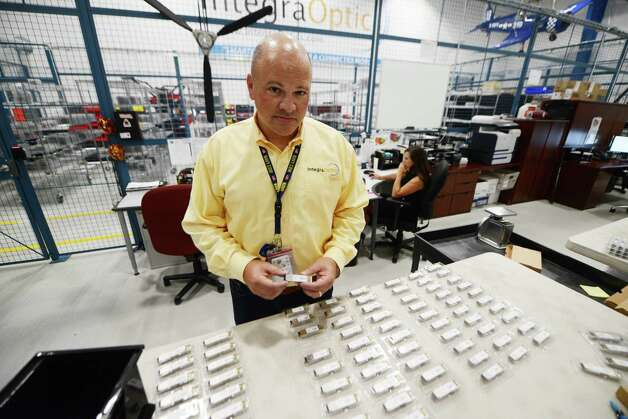 IntegraOptics CEO David Prescott holds an optical transceiver which is developed and marketed by his company Monday, July 27, 2015, at their offices at Albany International Airport in Colonie, N.Y. (Will Waldron/Times Union) Photo: WILL WALDRON / 00032783A