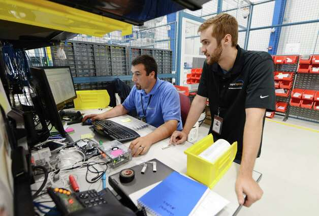 IntegraOptics electronics technicians Andrew Tremblay, left, and Ryan Soler, right, work on a project at the companies facilities at Albany International Airport Monday, July 27, 2015, in Colonie, N.Y. (Will Waldron/Times Union) Photo: WW / 00032783A