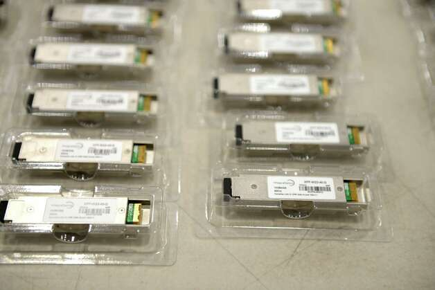 Optical transceiver developed and marketed by IntegraOptics Monday, July 27, 2015, at their offices at Albany International Airport in Colonie, N.Y. (Will Waldron/Times Union) Photo: WILL WALDRON / William L. Clements Library, University of Michigan