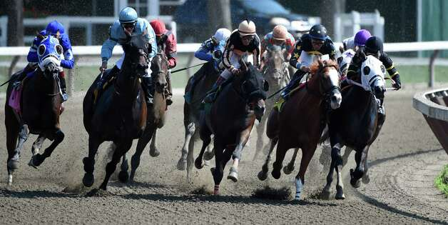 The field of the 6th race make the turn for home which was won by #5 Devilish Grin ridden by John Velazquez Monday afternoon at the Saratoga Race Course in July 27, 2015 in Saratoga Springs, N.Y.    (Skip Dickstein/Times Union) Photo: SKIP DICKSTEIN