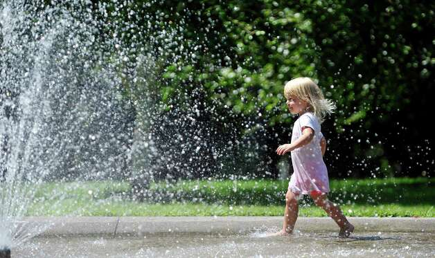 Sophia Murray, 2, of Watervliet plays in the spray pool at Prospect Park on Monday, July 27, 2015, in Troy, N.Y.  (Paul Buckowski / Times Union) Photo: PAUL BUCKOWSKI / 00032775A
