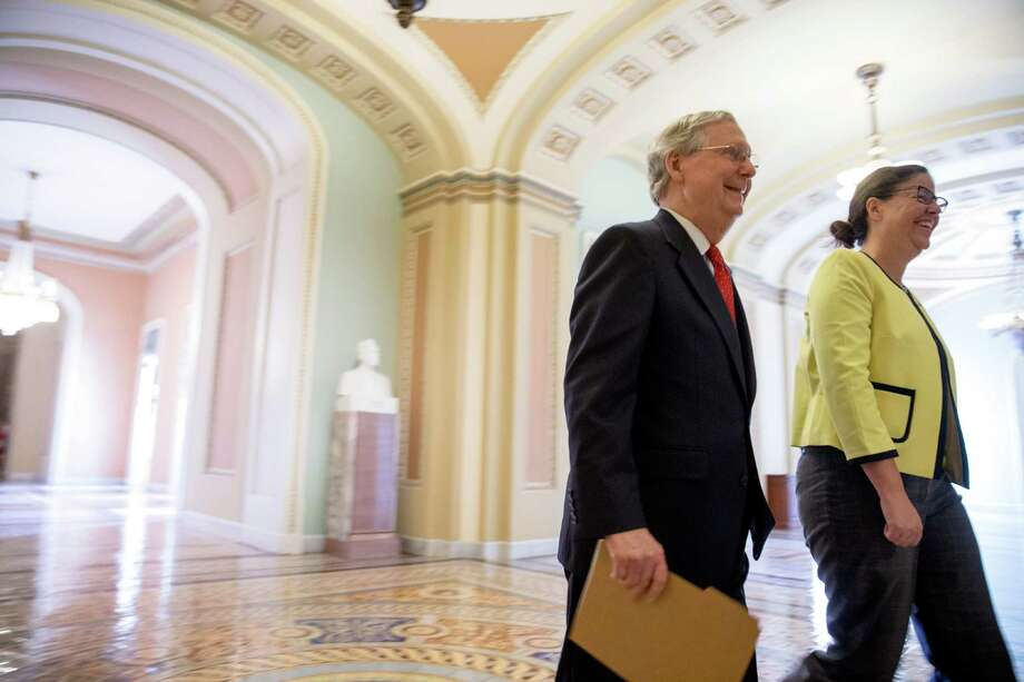 Senate Majority Leader Mitch McConnell, R-Ky., left, accompanied by Secretary for the Majority of the Senate Laura Dove, heads into the Senate chamber as the Senate convenes for a Sunday session on Capitol Hill in Washington, Sunday, July 26, 2015. On the agenda are efforts to repeal President Barack Obama's health care law and reviving the federal Export-Import Bank. (AP Photo/Andrew Harnik) ORG XMIT: DCAH103 Photo: Andrew Harnik / AP