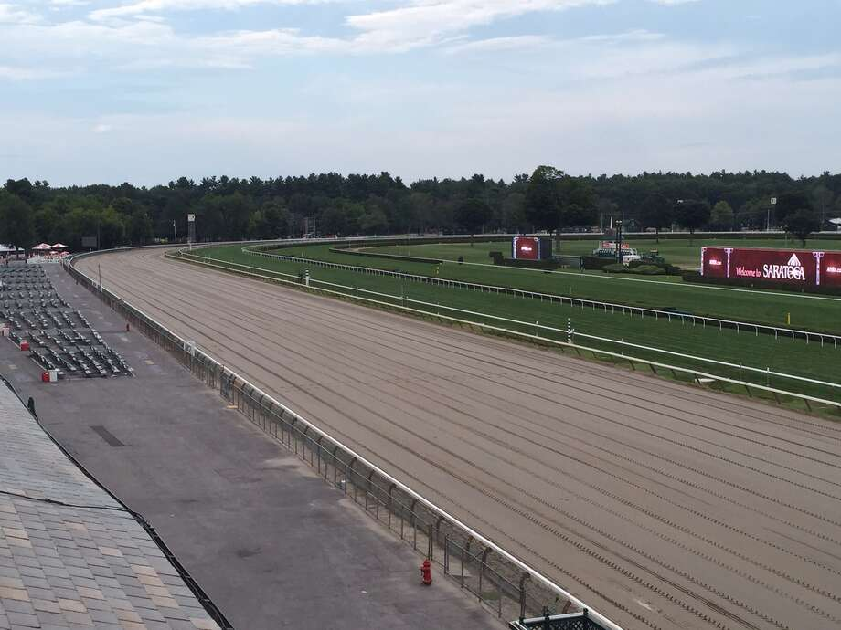 The fourth day of the Saratoga Race Course meet is history. This is the view of the track from the steward's stand a couple hours after the final race was run on a steamy Monday. Where did everyone go? The announced paid attendance was 18,446. If you were here Monday, you know there was nowhere near that many on the Spa grounds. But all the season passes count as a paid admission. So, you better get used to bigger attendance numbers. Don't want to hear anyone griping about it. (Tim Wilkin / Times Union)