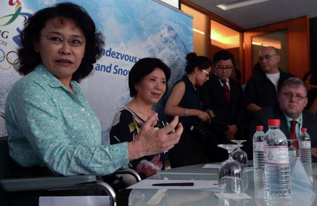 Zhang Haidi (L), Vice President of the Beijing 2022 Bid Committee, attends a media briefings in Kuala Lumpur on July 27, 2015.  Beijing Olympic officials shrugged off questions over snow levels and spread-out venues in their 2022 Winter Games bid as they launched their final pitch in Malaysia ahead of an IOC vote this week.   AFP PHOTO / MOHD RASFANMOHD RASFAN/AFP/Getty Images Photo: MOHD RASFAN / AFP