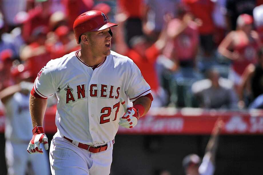 ANAHEIM, CA - JULY 26:  Mike Trout #27 of the Los Angeles Angels of Anaheim watches his grand slam home run as he runs to first base in the sixth inning during a game against the Texas Rangers at Angel Stadium of Anaheim on July 26, 2015 in Anaheim, California.  (Photo by Jonathan Moore/Getty Images) Photo: Jonathan Moore, Stringer / 2015 Getty Images