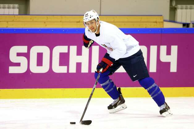 SOCHI, RUSSIA - FEBRUARY 20: Derek Stepan #12 of the United States handles the puck during their Men's Ice Hockey practice session on day thirteen of the Sochi 2014 Winter Olympics at Bolshoy Ice Dome on February 20, 2014 in Sochi, Russia.  (Photo by Paul Gilham/Getty Images) ORG XMIT: 470786137 Photo: Paul Gilham / 2014 Getty Images