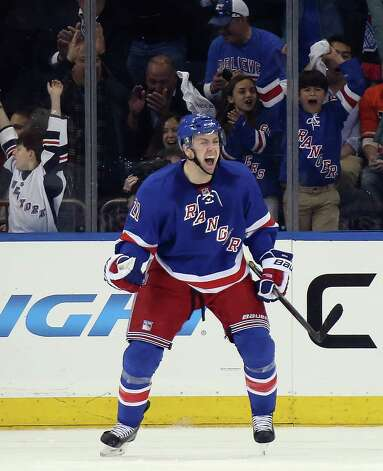 NEW YORK, NY - APRIL 17: Derek Stepan #21 of the New York Rangers celebrates his third period goal against the Philadelphia Flyers in Game One of the First Round of the 2014 NHL Stanley Cup Playoffs at Madison Square Garden on April 17, 2014 in New York City.  The Rangers defeated the Flyers 4-1. (Photo by Bruce Bennett/Getty Images) ORG XMIT: 485353579 Photo: Bruce Bennett / 2014 Getty Images
