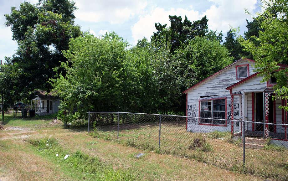 A house with graffiti on it is seen on Brandon Street in the Sunnyside neighborhood, Monday, July 27, 2015, in Houston. Photo: Cody Duty, Houston Chronicle / © 2015 Houston Chronicle