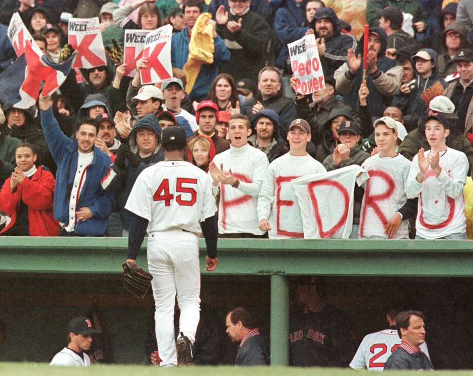 FILE - In this April 8, 2001, file photo, Boston Red Sox pitcher Pedro Martinez (45) is cheered by fans as he walks back to the dugout after striking out the side against the Tampa Bay Devil Rays at Fenway Park in Boston. All these years of playing in Fenway Park made it tough for pitchers. The Boston Red Sox haven't found one worth of a retired number, until they send Pedro Martinez's No. 45 to the Fenway Park Facade on Tuesday night, July 28, 2015. (AP Photo/Winslow Townson, File) ORG XMIT: NY157 Photo: WINSLOW TOWNSON / AP
