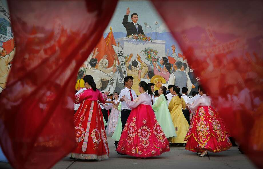 Students participate in a mass dance in front of a mural of the late North Korean leader Kim Il Sung, Monday, July 27, 2015, in Pyongyang, North Korea as part of celebrations for the 62nd anniversary of the armistice that ended the Korean War. Photo: Wong Maye-E, Associated Press