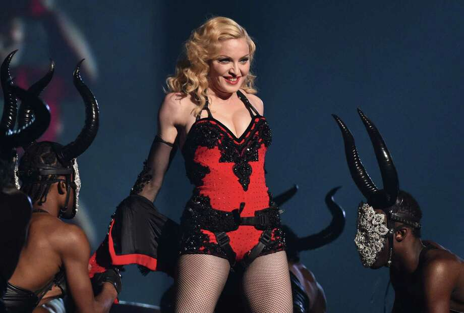 FILE - In this Feb. 8, 2015, file photo, Madonna performs at the 57th annual Grammy Awards in Los Angeles. Madonna, who co-owns Tidal with Jay Z, Beyonce and others, says it is just the beginning for the streaming service that's had some troubles since its launch in March. (Photo by John Shearer/Invision/AP, File) Photo: John Shearer, INVL / Invision