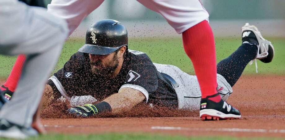 Chicago White Sox designated hitter Adam Eaton beats the tag by Boston Red Sox third baseman Pablo Sandoval on a triple during the first inning of a baseball game at Fenway Park in Boston, Monday, July 27, 2015. (AP Photo/Charles Krupa) ORG XMIT: MACK111 Photo: Charles Krupa / AP
