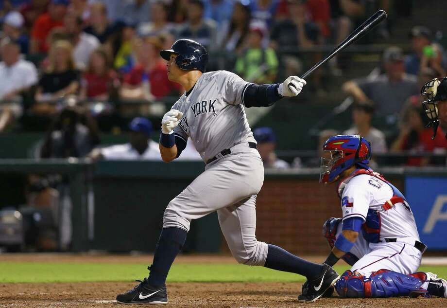 ARLINGTON, TX - JULY 27:  Alex Rodriguez #13 of the New York Yankees hits a solo home run against the Texas Rangers in the top of the sixth inning at Globe Life Park in Arlington on July 27, 2015 in Arlington, Texas.  (Photo by Tom Pennington/Getty Images) ORG XMIT: 538587473 Photo: Tom Pennington / 2015 Getty Images