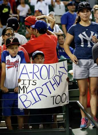 A young fan holds up a sign acknowledging New York Yankees' Alex Rodriguez's birthday after a baseball game between the Yankees and the Texas Rangers, Monday July 27, 2015, in Arlington, Texas. The Yankees won 6-2. (AP Photo/Tony Gutierrez) ORG XMIT: ARL127 Photo: Tony Gutierrez / AP