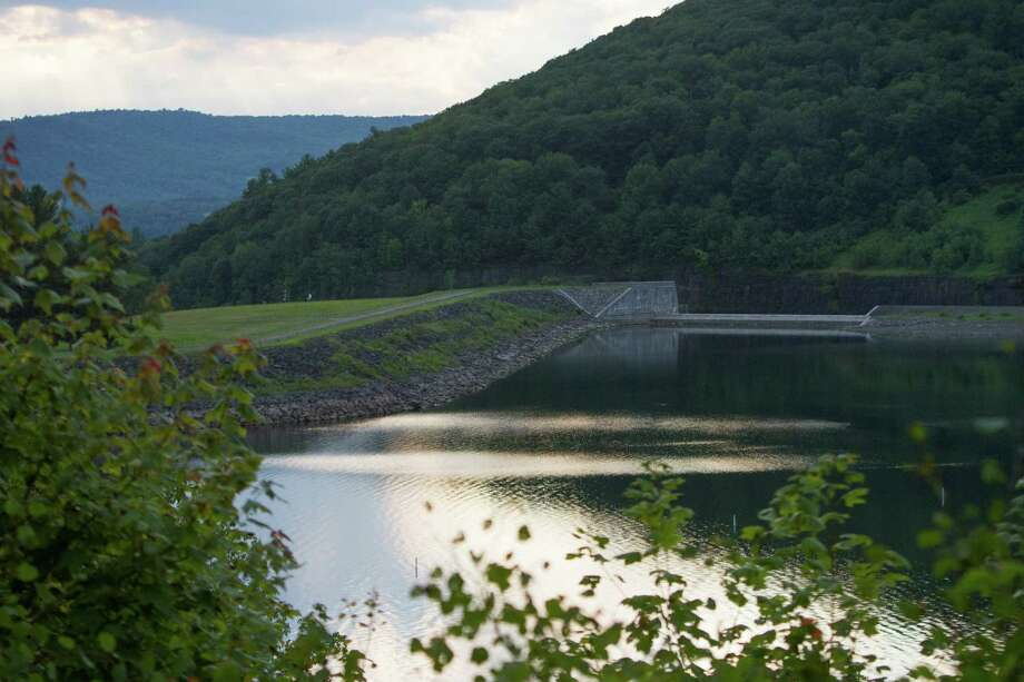 The Cannonsville Dam in Delaware County, New York, July 23, 2015. Officials are working to contain the effects of a potentially dangerous accident that has allowed water to seep out of a rock embankment near the base of the 175-foot-high earthen dam that forms this reservoir which serves New York City. (Emma Tannenbaum/The New York Times) Photo: EMMA TANNENBAUM / NYTNS