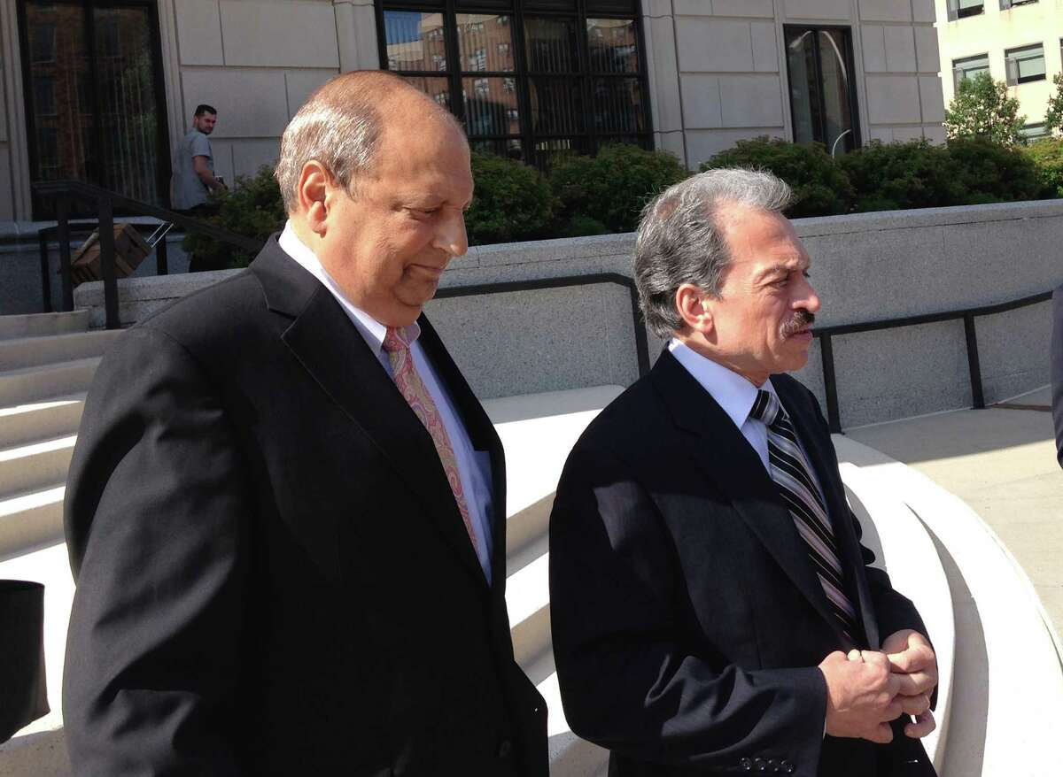 Sen. Thomas Libous, R-Binghamton, left, leaves federal court in White Plains, N.Y., with his attorney, Paul DerOhannesian, after being convicted of lying to federal agents, Wednesday, July 22, 2015. Libous, who is the Senate's deputy majority leader, was found guilty for lying to the FBI about arranging a high-paying job for his son. (AP Photo/Jim Fitzgerald)
